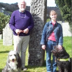 Tony Susan and dogs by carved stone